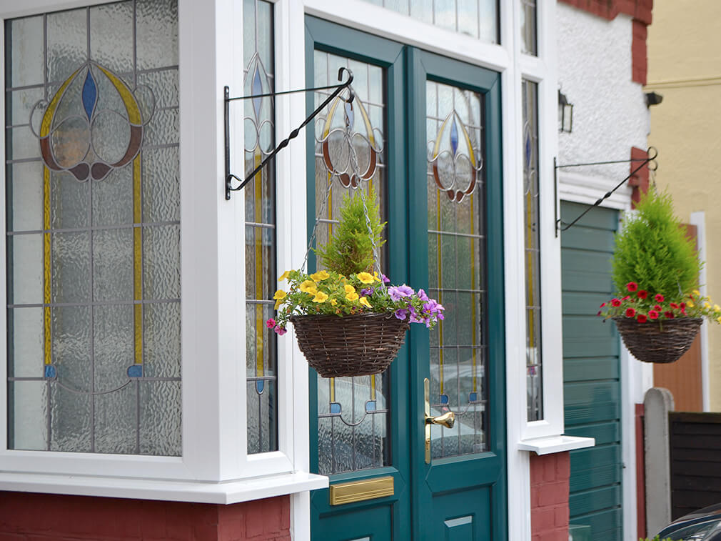 Green coloured uPVC entrance door and porch