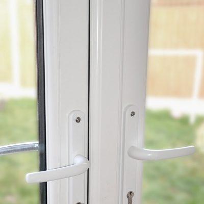 White uPVC french door handles