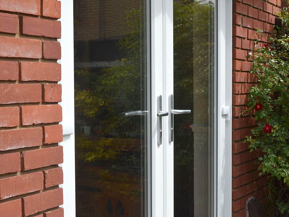 White uPVC french door with silver hardware