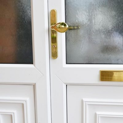 White uPVC entrance door with gold hardware